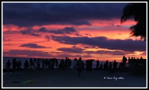 Sunset worshippers gather on Waikiki Beach.