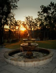Rural sunset and fountain
