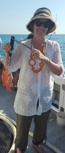 Jen catches her first deep sea fish - which just happens to match the necklace!