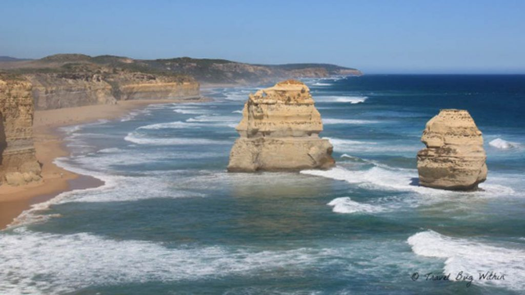 Image of a the Australian coastline and two large rocks protrucing from the water