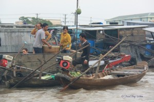 boat vendors ply their wares