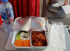 Image of a silver foil tray tray on a folded out airline table