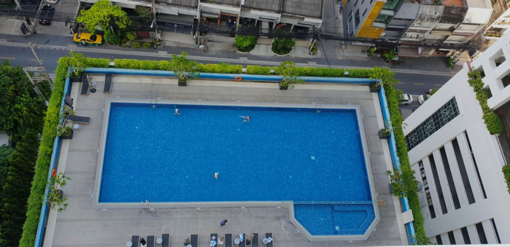 Aerial image of a large hotel swimmming pool taken from above