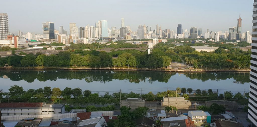 Image of a city scape in the background and a river inteh foreground