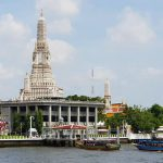 image of a tall white temple building as seen from a riverboat