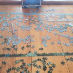 Table covered in pieces of a jigsaw puzzle making a border