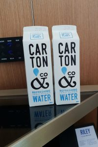two cardboard cartons used to hold water