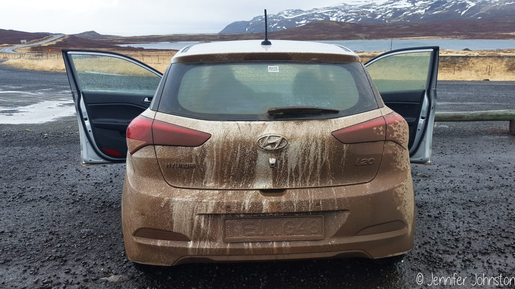 Small car covered in brown dirt