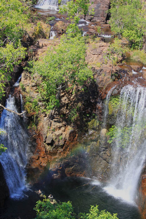 Image of two waterfalls cascading over a cliff and into a large pool of water