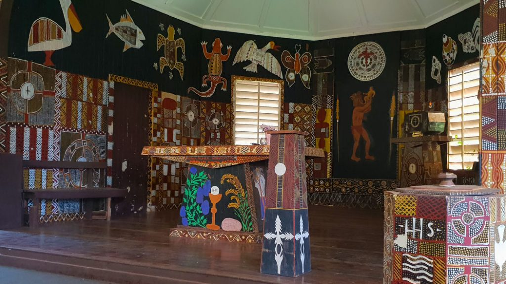 Image showing the altar of an Indigenous church with murals of animals covering the walls and pulpit