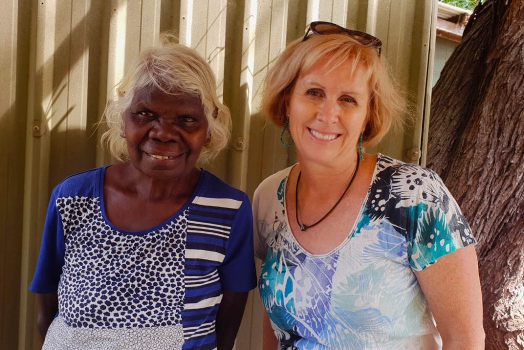 Image of an Indigenous Australian woman standing next to the author of the story - both women are smiling for the photo