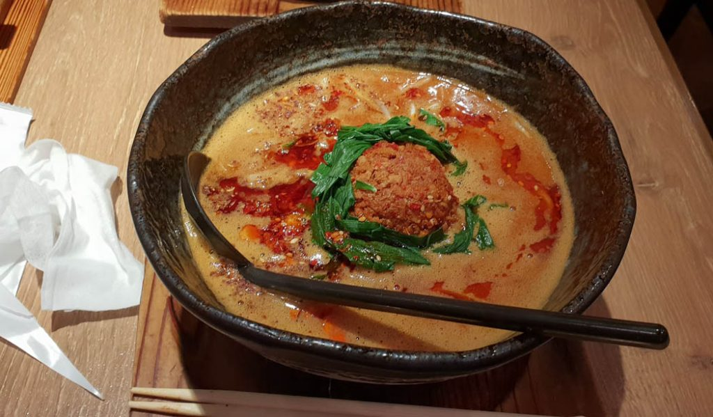 IMage of a large bowl of Japanese ramen and a spoon