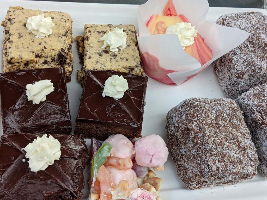 Image of a plate of sweet homemade treats - lamingtons and chocolate brownie