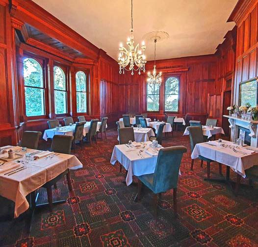 Image of the interior of a restaurant with cedar panelled walls and dark carpet