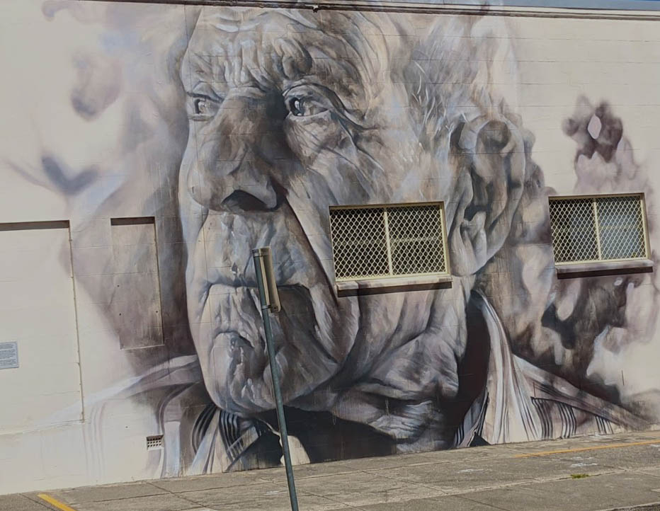 Image of a large mural of a man's face on a wall