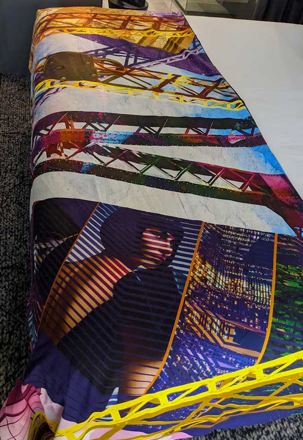 Image of a brightly coloured throw on a bed