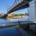 Image of a City Cat Ferry passing under the Story Bridge in Brisbane